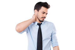 Feeling pain in neck. Stock Images