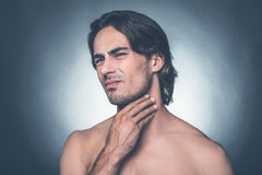 Feeling pain in throat. Royalty Free Stock Image