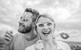 Feeling playful. Couple in love enjoy party time on cloudy sky. Sexy woman and sexi man wear fake glasses accessories. Feeling playful. Couple in love enjoy stock images