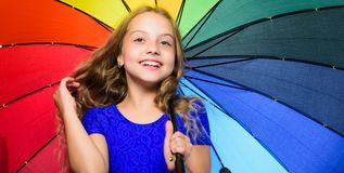 Feeling protected at this autumn day. Happy childhood. School time. Small girl with umbrella in rainy weather. Happy royalty free stock images