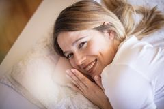 Feeling rested and refreshed. Woman waking up royalty free stock image
