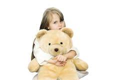 Feeling safe. The girl is hugging big teddy bear stock images