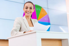 Feeling satisfied with her speech. Royalty Free Stock Images