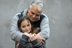 Feeling of security. Father cuddles his sweet teenage daughter and gives her a feeling of security Stock Photo