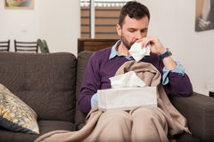 Feeling sick with the flu at home Stock Photo
