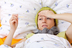 Feeling sick and having high fever Royalty Free Stock Photography
