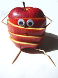 Feeling sliced!. An apple a day keeps the doctor away?? Not more! Nowdays also the apples are stressed Stock Image