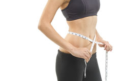 Feeling thin. A thin female waist shown being measured. Photographed in studio royalty free stock images