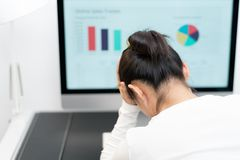 Feeling tired and stressed. young woman suffer from working while sitting at her working place in office royalty free stock image