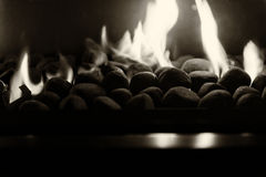 Feeling warmth by the fire place Royalty Free Stock Image