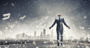 That feeling when you did it right!. Joyful businessman with outstretched arms celebrating success Stock Photo