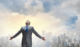 That feeling when you did it right!. Joyful businessman with outstretched arms celebrating success Stock Photography