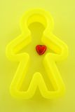 Feelings. Red heart inside shape man on a yellow background Royalty Free Stock Photo