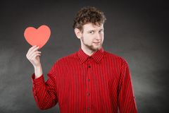 Cheerful man holding heart. Stock Photography