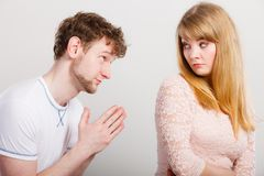 Woman angry on man apologizing her. Feelings after argument in relationship. Lovers in argue women angry on man. Guy trying to apologize say sorry to his stock photos