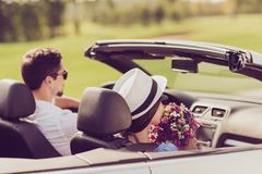 Feelings, married family, friendship, reach destination, escape, speed ride lifestyle. Carefree cheerful driver husband, lady. Wife with gift present on their stock photography