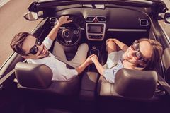 Feelings, married family, friendship, reach destination, escape, speed ride lifestyle. Carefree driver husband, lady wife hold ar. Ms, on their way to dreams and royalty free stock images