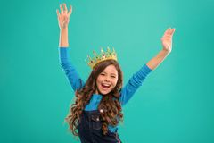 Feels like queen. Kid wear golden crown symbol of princess. Lady little princess. Girl cute baby wear crown while stand. Blue background. Childhood concept royalty free stock photos