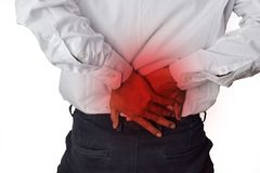 Feels pain in the small of the back. Back Pain, Physical Injury stock image