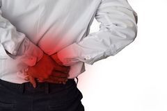Feels pain in the small of the back. Back Pain, Physical Injury stock photo
