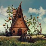 Feenhaftes Haus mit Pilzen und Efeu Stockbild