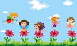 Feer som flyger i blommaträdgård Arkivbild