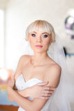Fees bride on the wedding day. Morning bride on a sunny day wedding day Stock Photography