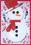 Feestelijke lijst die voor Kerstmis plaatst Het ornament van Kerstmis Stock Foto