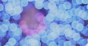 Feestelijke vaag helder bokeh De vage abstracte achtergrond van Kerstmislichten stock video