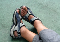 Feet. Of man lying on boat-deck of cross-channel ferry Royalty Free Stock Photo