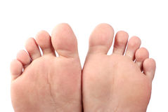 Feet. Isolated on white background Royalty Free Stock Photography