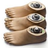 Feet. Three left artificial feet on white Stock Photo