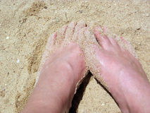 Feet. Bare feet digging in sand Stock Photography