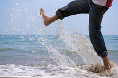 Feet. Of the man going on a coastal line and doing splashes Royalty Free Stock Image
