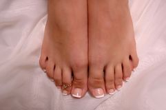 Feet. Pedicured feet on silk cloth Stock Photography