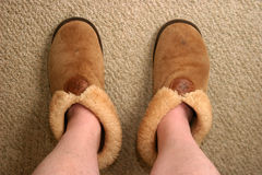 Feet. Genuine human feet in slippers royalty free stock photos