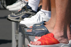 Feet. Shot of feet on bleachers royalty free stock photography