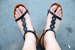 Feet. Beautiful feets in black sandals Stock Image