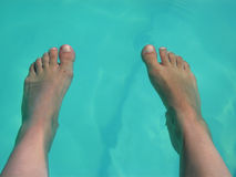 Feet. Naked feet on the water Royalty Free Stock Images