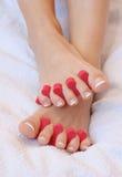 Feet. Ready to applying nail polish stock photo