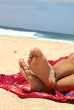 Feet. On red blanket Stock Photography
