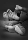 Feet. A good mix of childrens feet. on a sweep in black and white Stock Image
