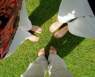 Feet. Bare Feet on the Green Grass Royalty Free Stock Image