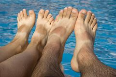 Feet agains blue water Royalty Free Stock Images