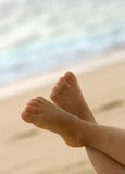 Feet in the air. Child feet in the air with sand Royalty Free Stock Photography