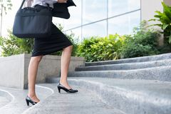 Free Feet And Leg Of Businesswoman Wearing Black High Heel Shoes Going Up The Stairs Outdoors. Woman Go To Work At Office. Royalty Free Stock Images - 99301589