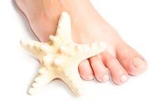 Feet And Starfish Royalty Free Stock Photos