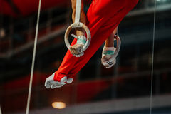Feet athlete gymnast. Still rings exercise in gymnastics stock photo