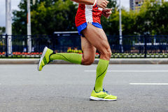Feet athlete man running. City marathon in compression socks Royalty Free Stock Photo