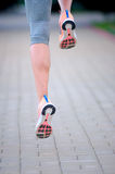 Feet of an athlete running on a park pathway training for fitnes Stock Photo